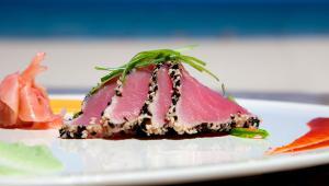 Sesame Seared Tuna! Sushi grade encrusted tuna, served with wakami slaw, wasabi, pickled ginger ponzu